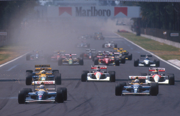 1992 Mexican Grand Prix.Mexico City, Mexico.20-22 March 1992.Nigel Mansell leads teammate Riccardo Patrese (both Williams FW14B Renault's), Martin Brundle (Benetton B191B Ford), Ayrton Senna, Gerhard Berger (both McLaren MP4/6B Honda's) and Michael Schumacher (Benetton B191B Ford) at the start.Ref-92 MEX 03.World Copyright - LAT Photographic