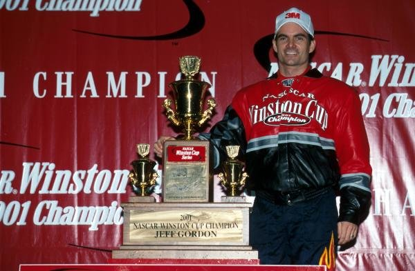 Fourth time NASCAR Winston Cup title winner Jeff Gordon (USA) shows off his trophy.