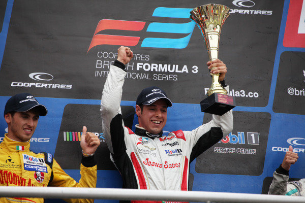 Brands Hatch, Kent. 10th - 11th August 2013.  Felipe Guimaraes, Fortec, celebrates on the podium.  Ref: IMG_3342a. World Copyright: Kevin Wood/LAT Photographic