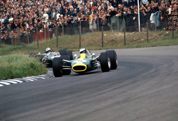 Zandvoort, Holland. 2nd - 4th June 1967. Jim Clark (Lotus 49-Ford), 1st position, leads Denny Hulme (Brabham BT20-Repco) 3rd positiom, action. World Copyright: LAT Photographic.Ref:  67HOL02