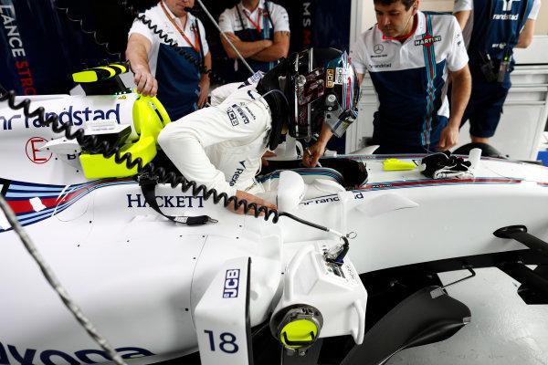 Albert Park, Melbourne, Australia. Friday 24 March 2017. Lance Stroll, Williams Martini Racing, climbs into his car. World Copyright: Glenn Dunbar/LAT Images ref: Digital Image _X4I8667