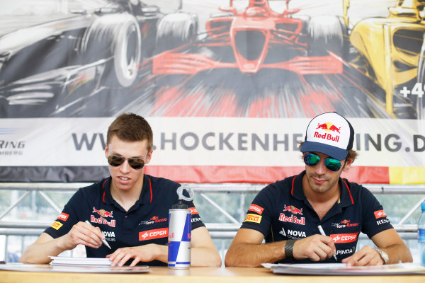 Hockenheimring, Hockenheim, Germany. Saturday 19 July 2014. Daniil Kvyat, Toro Rosso, and Jean-Eric Vergne, Toro Rosso, sign autographs for fans. World Copyright: Charles Coates/LAT Photographic. ref: Digital Image _J5R4498
