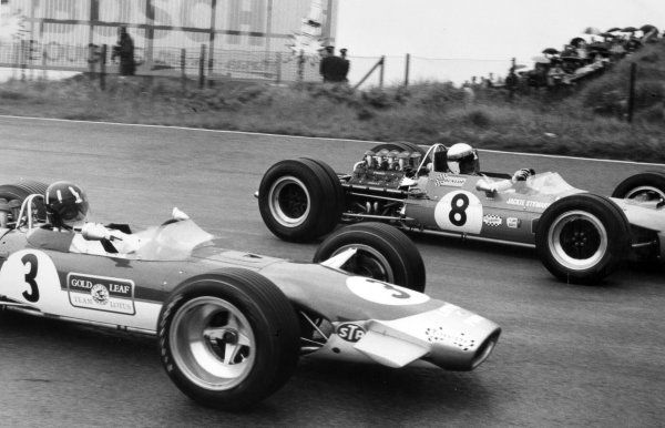 1968 Dutch Grand Prix.Zandvoort, Holland. 23 June 1968.Graham Hill, #3 Lotus 49B-Ford, 9th position, and Jackie Stewart, #8 Matra MS10-Ford, 1st position, action.World Copyright: LAT PhotographicRef: Motor b&w print