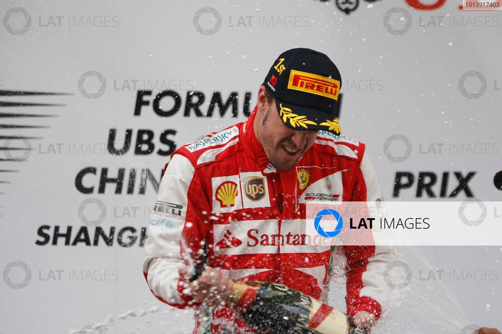 Shanghai International Circuit, Shanghai, China Sunday 14th April 2013 Fernando Alonso, Ferrari, 1st position, sprays the Champagne. World Copyright: Glenn Dunbar/LAT Photographic ref: Digital Image _89P9050