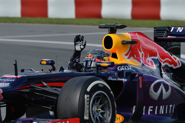 Race winner Sebastian Vettel (GER) Red Bull Racing RB9 waves to the crowd at the end of the race. Formula One World Championship, Rd7, Canadian Grand Prix, Race Day, Montreal, Canada, Sunday 9 June 2013. BEST IMAGE