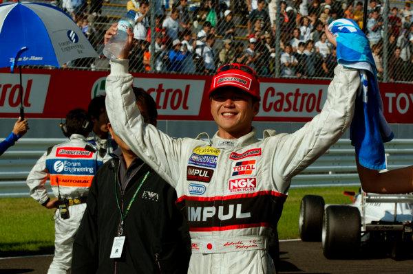 2003 Formula Nippon ChampionshipSugo, Japan. 27th July 2003.Race winner Satoshi Motoyama, celebrates.World Copyriht: Yasushi Ishihara/LAT Photographicref: Digital Image Only
