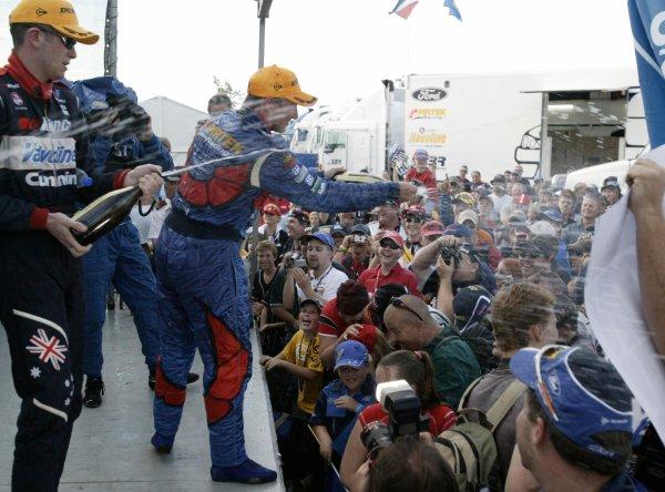 2004 Australian V8 Supercarsrd 6, Queensland Raceway, Brisbane. 4th July.Winner Marcos Ambrose sprays the champagne on the podium.World Copyright: Mark Horsburgh/LAT Photographicref: Digital Image Only