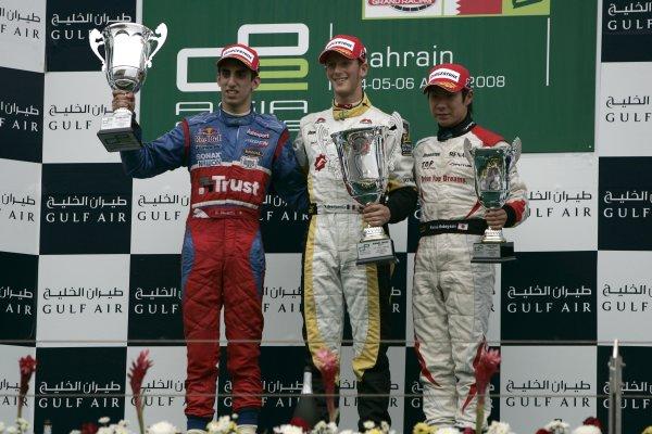 2008 GP2 Asia Series. Saturday Race.Bahrain International Circuit. Sakhir, Bahrain. 5th April. Romain Grosjean (FRA, ART Grand Prix) celebrates victory on the podium with Sebastien Buemi (SUI, Trust Team Arden) and Kamui Kobayashi (JPN, Dams). World Copyright: Alastair Staley/GP2 Series Media Service. Service ref:__MG_3586 jpg