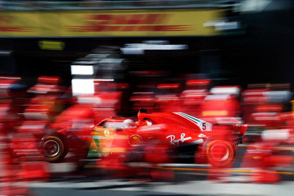 Sebastian Vettel, Ferrari SF71H, makes a pit stop.