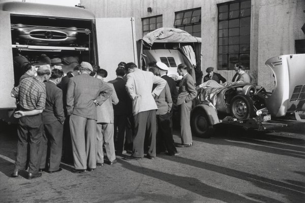 1954 French Grand Prix.Reims, France. 4 July 1954.The transporters arrive with the cars for Juan Manuel Fangio, Mercedes-Benz W196, 1st position, Hans Herrmann, Mercedes-Benz W196, retired, and Karl Kling, Mercedes-Benz W196, 2nd position, atmosphere.World Copyright: LAT PhotographicRef: 207/15