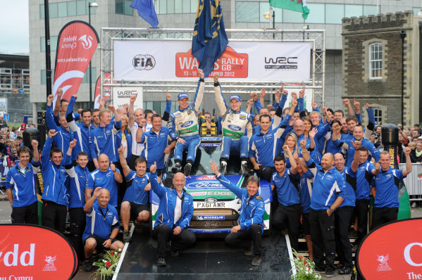 Jari-Matti Latvala (FIN) and Miikka Anttila (FIN), Ford Fiesta RS WRC celebrate victory with the Ford Team on the podium. FIA World Rally Championship, Rd10, Wales Rally GB, Day Three, Cardiff, Wales, 16 September 2012.