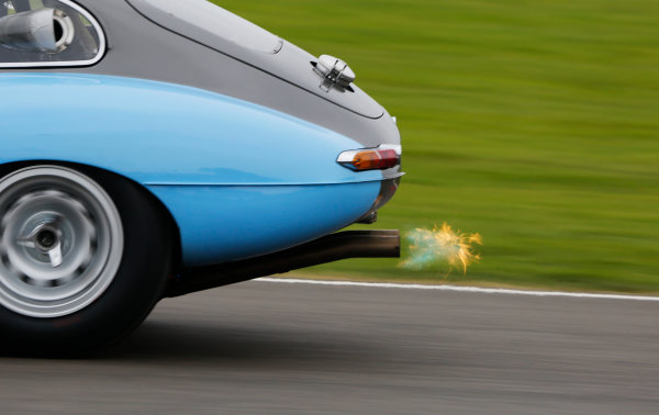 2015 Goodwood Revival Meeting.  Goodwood Estate, West Sussex, England. 11th - 13th September 2015.  TT Celebration.  Exhaust flame from the Gregor Fisken / Bobby Verdon-Roe Jaguar E-Type.  Ref: _W5_6012. World copyright: Kevin Wood/LAT Photographic