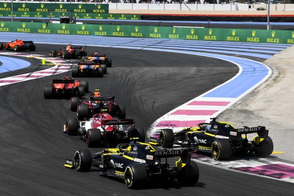 Charles Leclerc, Ferrari SF90, leads Max Verstappen, Red Bull Racing RB15, Carlos Sainz Jr., McLaren MCL34, Lando Norris, McLaren MCL34, Sebastian Vettel, Ferrari SF90, Pierre Gasly, Red Bull Racing RB15, Antonio Giovinazzi, Alfa Romeo Racing C38, Daniel Ricciardo, Renault R.S.19, and Nico Hulkenberg, Renault R.S. 19, on the opening lap