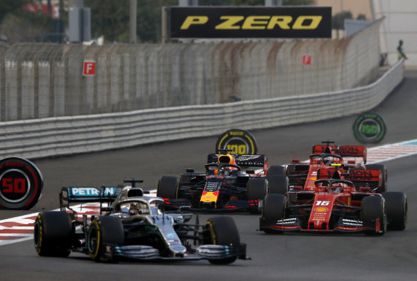 Lewis Hamilton, Mercedes AMG F1 W10, leads Charles Leclerc, Ferrari SF90, Max Verstappen, Red Bull Racing RB15, and Sebastian Vettel, Ferrari SF90, on the opening lap
