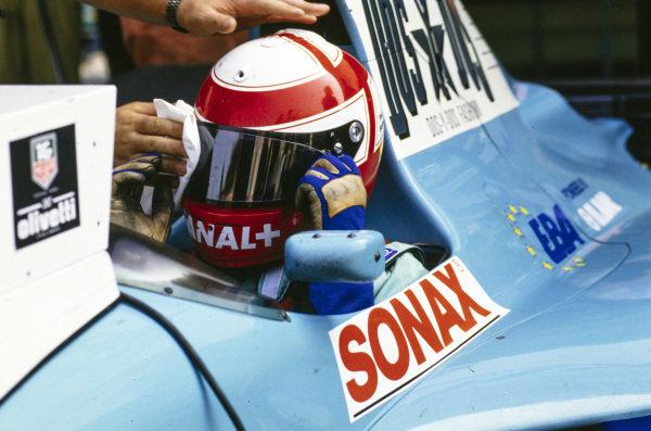 Paul Belmondo, March CG911 Ilmor, has his visor cleaned.