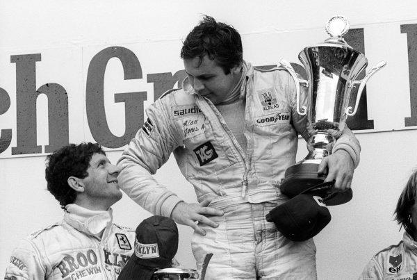 (L to R): Second placed Jody Scheckter (RSA) Ferrari, talks with race winner Alan Jones (AUS) Williams, on the podium.Formula One World Championship, Rd12, Dutch Grand Prix, Zandvoort, Holland. 26 August 1979.
