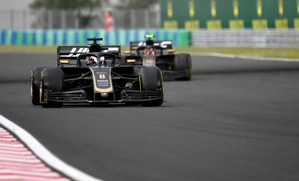 Romain Grosjean, Haas VF-19, leads Kevin Magnussen, Haas VF-19