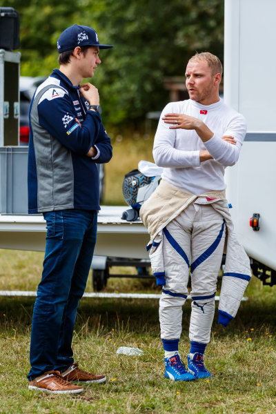 Valtteri Bottas talks with Teemu Suninen while testing an M-Sport Ford Fiesta WRC
