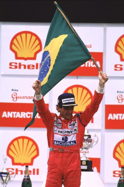 1991 Brazilian Grand Prix.Interlagos, Sao Paulo, Brazil.22-24 March 1991.Ayrton Senna (McLaren Honda) 1st position on the podium.World Copyright - LAT Photographic