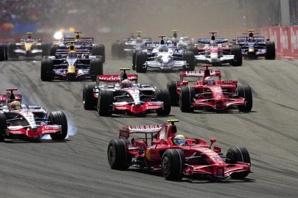 Felipe Massa, Ferrari F2008 leads Lewis Hamilton, McLaren MP4-23 Mercedes as Kimi Räikkönen, Ferrari F2008 and Heikki Kovalainen, McLaren MP4-23 Mercedes battle behind.