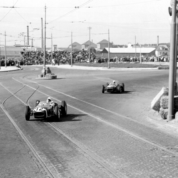1960 Portuguese Grand Prix.Porto, Portugal.12-14 August 1960.Stirling Moss (Cooper T53 Climax) followed by John Surtees (Lotus 18 Climax), action. Ref-7073B/W.World Copyright - LAT Photographic