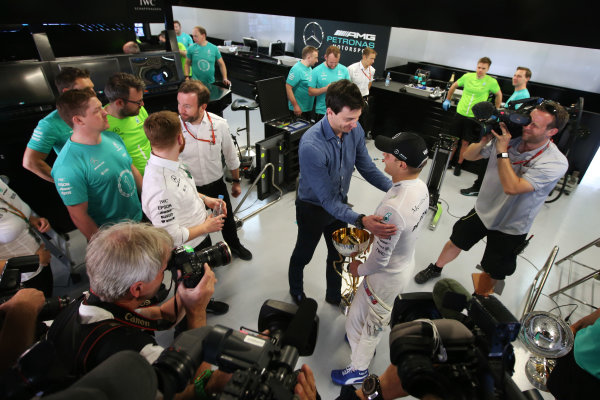 Sochi Autodrom, Sochi, Russia. Sunday 30 April 2017. Valtteri Bottas, Mercedes AMG, is congratulated on his win by Toto Wolff, Executive Director (Business), Mercedes AMG, in the team's garage. World Copyright: LAT Images ref: Digital Image DJ5R9734
