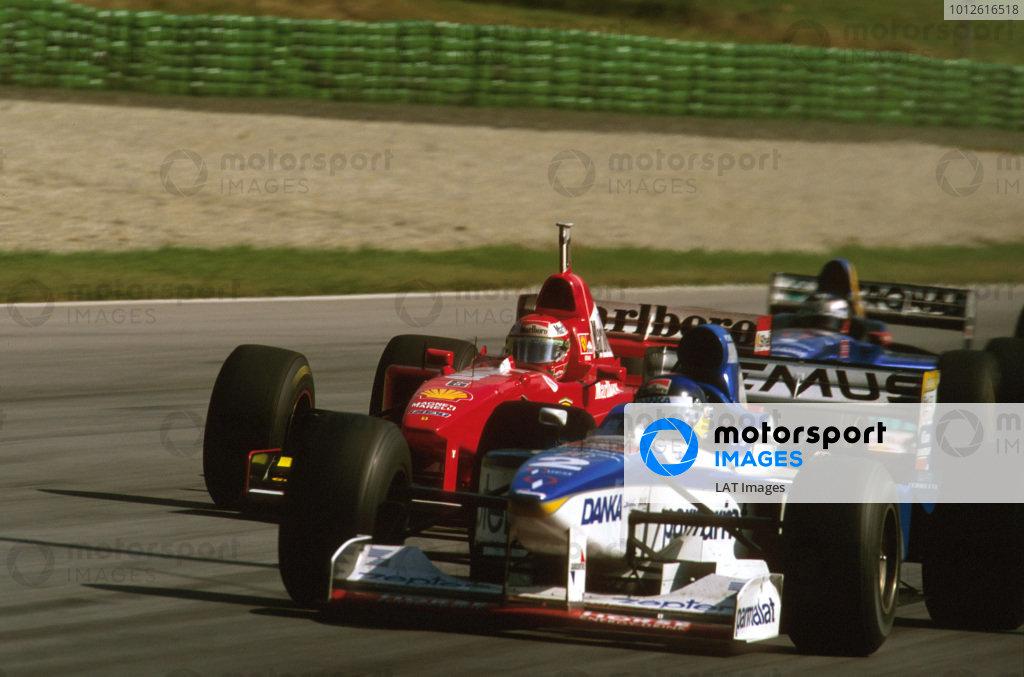 A1-Ring, Zeltweg, Austria.19-21 September 1997.Eddie Irvine (Ferrari F310B) behind Pedro Diniz's Arrows.Ref-97 ITA 06.World Copyright - LAT Photographic