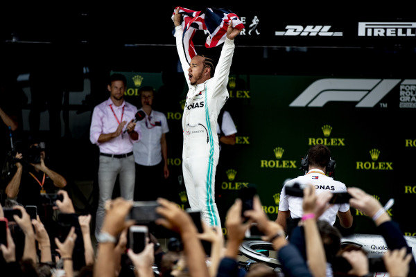 Lewis Hamilton, Mercedes AMG F1, 1st position, celebrates with a Union flag in Parc Ferme