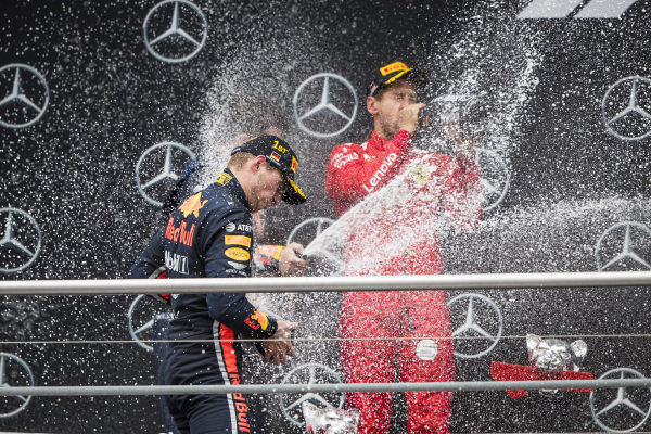 Race winner Max Verstappen, Red Bull Racing and Sebastian Vettel, Ferrari celebrates on the podium with the champagne
