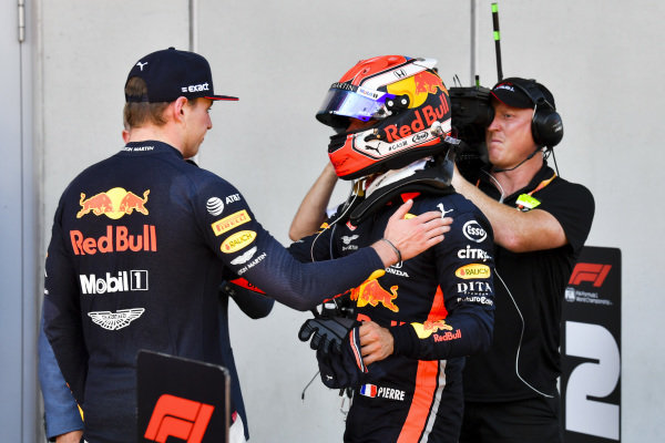 Pierre Gasly, Red Bull Racing, congratulates team mate Max Verstappen, Red Bull Racing, 1st position, in Parc Ferme