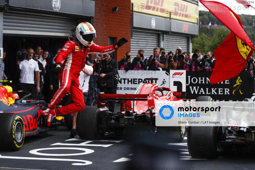 Sebastian Vettel, Ferrari SF71H, celebrates victory with a jump in parc ferme.