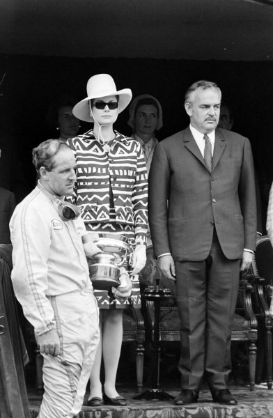 Denny Hulme, 1st position, on the podium with Princess Grace of Monaco and Prince Rainier.