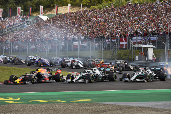 Max Verstappen, Red Bull Racing RB15, leads Lewis Hamilton, Mercedes AMG F1 W10, Valtteri Bottas, Mercedes AMG W10, and the rest of the field at the start