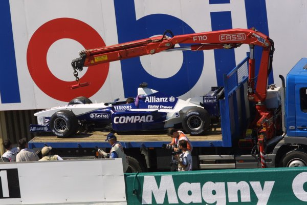 2001 French Grand Prix - Friday PracticeMagny-Cours, France. 29th June 2001Ralf Schumacher's BMW Williams FW23, is loaded on the back of a transporter after breaking down during the practice session.World Copyright - LAT Photographicref: 8 9 MB Digital File only