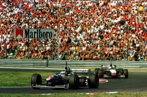 1997 Hungarian Grand Prix.Hungaroring, Budapest, Hungary.8-10 August 1997.Jacques Villeneuve (Williams FW19 Renault) leads David Coulthard (McLaren MP4/12 Mercedes-Benz). Villeneuve finished in 1st position after taking the lead on the last lap.World Copyright - LAT Photographic