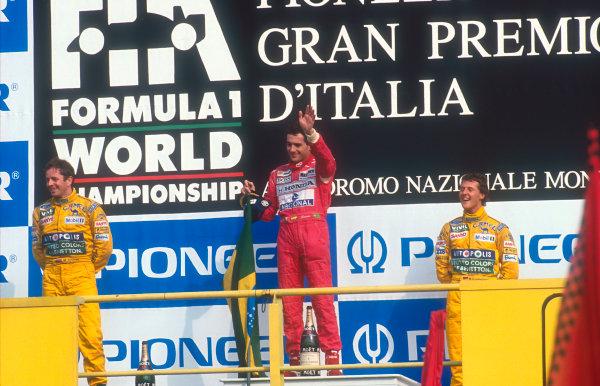 1992 Italian Grand Prix.Monza, Italy.11-13 September 1992.Ayrton Senna (McLaren MP4/7A Honda) 1st position, Martin Brundle (Benetton B192 Ford) 2nd position and Michael Schumacher (Benetton B192 Ford) 3rd position on the podium.Ref-92 ITA 04.World Copyright - LAT Photographic