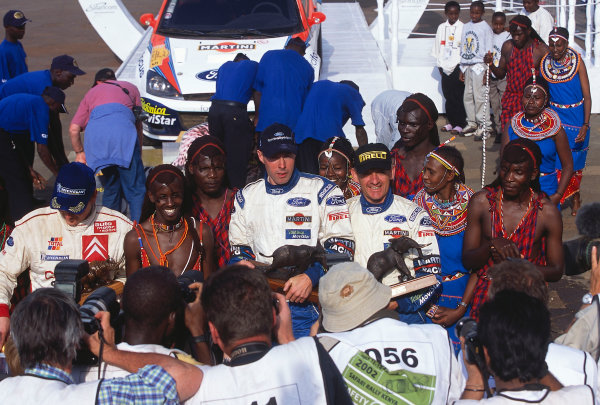 2002 World Rally ChampionshipSafari Rally, Kenya. 11th - 14th July 2002.Rally winner Colin McRae/Nicky Grist (Ford Focus RS WRC02), podium.World Copyright: McKlein/LAT Photographicref: 35mm Image A23