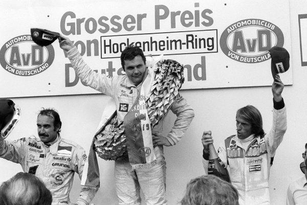 The podium (L to R): Clay Regazzoni (SUI) Williams, second; Alan Jones (AUS) Williams, race winner; Jacques Laffite (FRA) Ligier, third.German Grand Prix, Rd 10, Hockenheim, Germany, 29 July 1979.