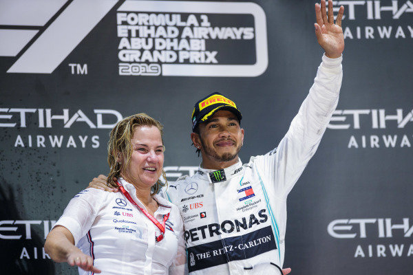 The Mercedes trophy delegate and Lewis Hamilton, Mercedes AMG F1, 1st position, on the podium