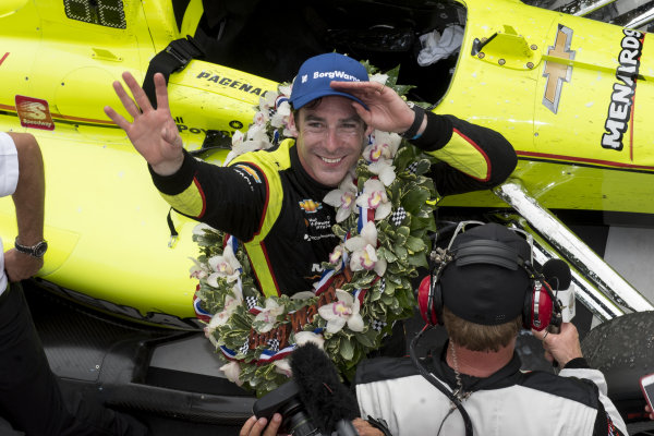 Simon Pagenaud, Team Penske Chevrolet, waves in victory lane.