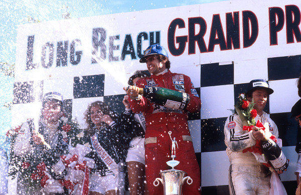 1978 United States Grand Prix West.Long Beach, California, USA.31/3-2/4 1978.Carlos Reutemann (Ferrari) 1st position, Mario Andretti (Team Lotus) 2nd position and Patrick Depailler (Tyrrell Ford) 3rd position celebrate on the podium.Ref-78 LB 05.World Copyright - LAT Photographic