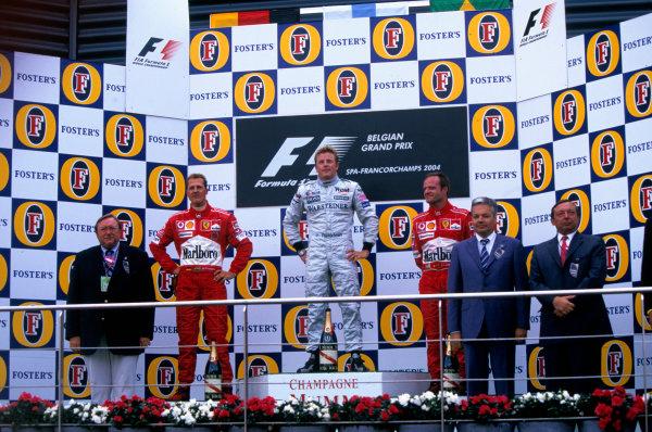 2004 Belgian Grand Prix.Spa Francorchamps, Belgium. 27th - 29th August.Kimi Raikkonen, McLaren Mercedes MP4/19B , Michael Schumacher, Ferrari F2004 and Rubens Barrichello, Ferrari F2004 celebrate on the podium.World Copyright:LAT PhotographicRef:35mm Image A22