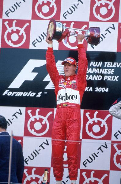 2004 Japanese Grand Prix.Suzuka , Japan 8th - 10th October 2004Michael Schumacher, Ferrari F2004 celebrates his win on the podium.World Copyright:Peter Spinney/LAT Photographic ref: 35mm Image: A23