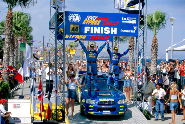 2003 World Rally ChampionshipRally of Cyprus, Cyprus. 19th - 22nd June 2003.Rally winner Petter Solberg/Philip Mills (Subaru Impreza WRC 2003), podium.World Copyright: McKlein/LAT Photographicref: 03WRCCyprus13