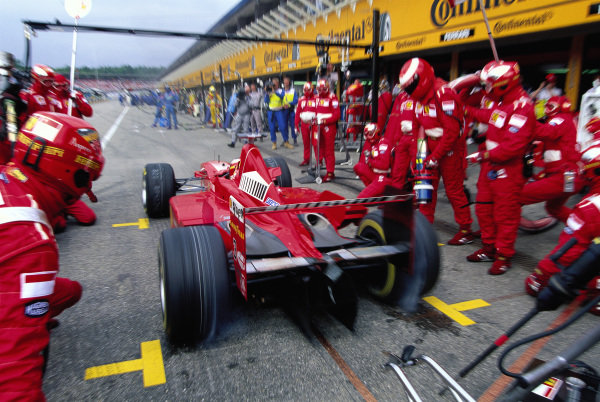 Michael Schumacher, Ferrari F300, completes a pitstop.