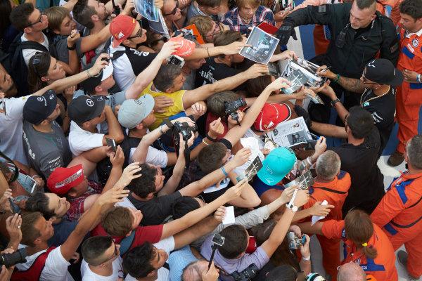 Autodromo Nazionale di Monza, Monza, Italy. Thursday 3 September 2015. Lewis Hamilton, Mercedes AMG, signs autographs for fans. World Copyright: Steve Etherington/LAT Photographic ref: Digital Image SNE23401