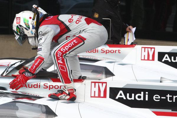 2013 FIA WEC Championship, Silverstone, Northamptonshire. 12th - 14th April 2013. Allan McNish Audi R18 e-tron quattro celebrates the win World Copyright: Ebrey / LAT Photographic.