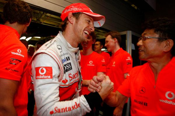 Shanghai International Circuit, Shanghai, China 18th April 2010 Jenson Button, McLaren MP4-25 Mercedes, 1st position, celebrates victory with his team. Portrait.  World Copyright: Charles Coates/LAT Photographic ref: Digital Image _26Y1084