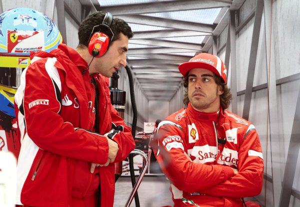 Silverstone, Northamptonshire, England 8th July 2011 Fernando Alonso, Ferrari F150° Italia, with Andrea Stella, Race Engineer, Ferrari. Portrait.  World Copyright: Steve Etherington/LAT Photographic ref: Digital Image F72E9526