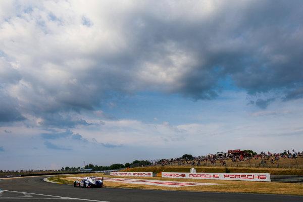 2015 Le Mans 24 Hours. Circuit de la Sarthe, Le Mans, France. Thursday 11 June 2015. Toyota Racing (Toyota TS 040 Hybrid - LMP1), Anthony Davidson, Sebastien Buemi, Kazuki Nakajima.  World Copyright: Zak Mauger/LAT Photographic. ref: Digital Image _L0U3463